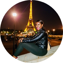 woman smiling at night with eiffel tower in the background